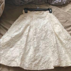 white knee-length skirt